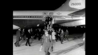 Shocked and dismayed, the nation looks on as former president John F. Kennedy's body is flown to Washington D.C. and Lyndon B. Johnson is sworn into office ...