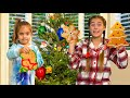 Nastya and Mia decorate the Christmas tree with cookies