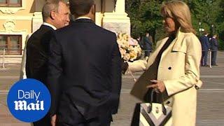Putin gifts Brigitte Macron flowers as Emmanuel Macron visits Russia