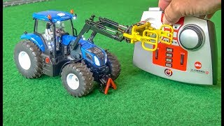 RC tractor gets unboxed and tested! Hay bale gripper!