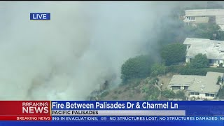 Water-Dropping Helicopters Conducting An Aerial Assault On Pacific Palisades Brush Fire