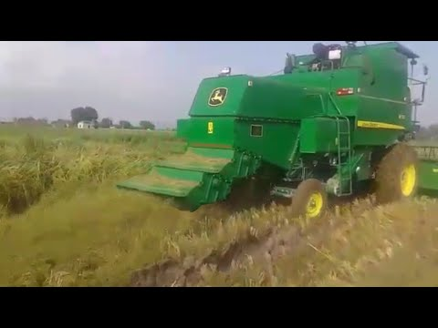 John Deere combine with SMS in wet and...