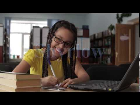 Girl with long hair wearing glasses in the school library 6 mov