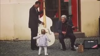 Toddler Connecting with Singers on the Street