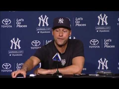 Derek Jeter answers phone during Derek Jeter Day press conference
