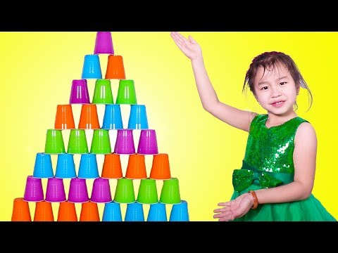 Jannie Stacking A HUGE Cup Pyramid