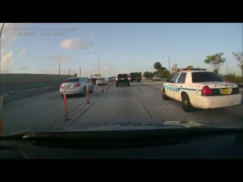 Miami-Dade Schools police officer driving distracted - FL 233699