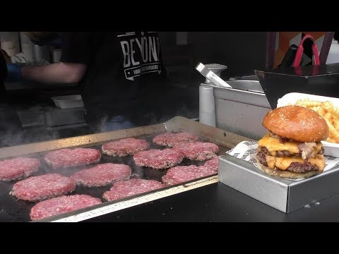 Massive Dose of Beef for Many Burgers. Cooked in Camden Town. London Street Food