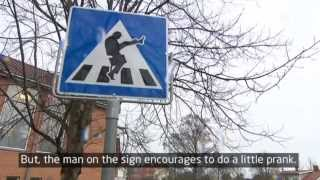 Traffic sign makes people do the Monty Python Silly Walk