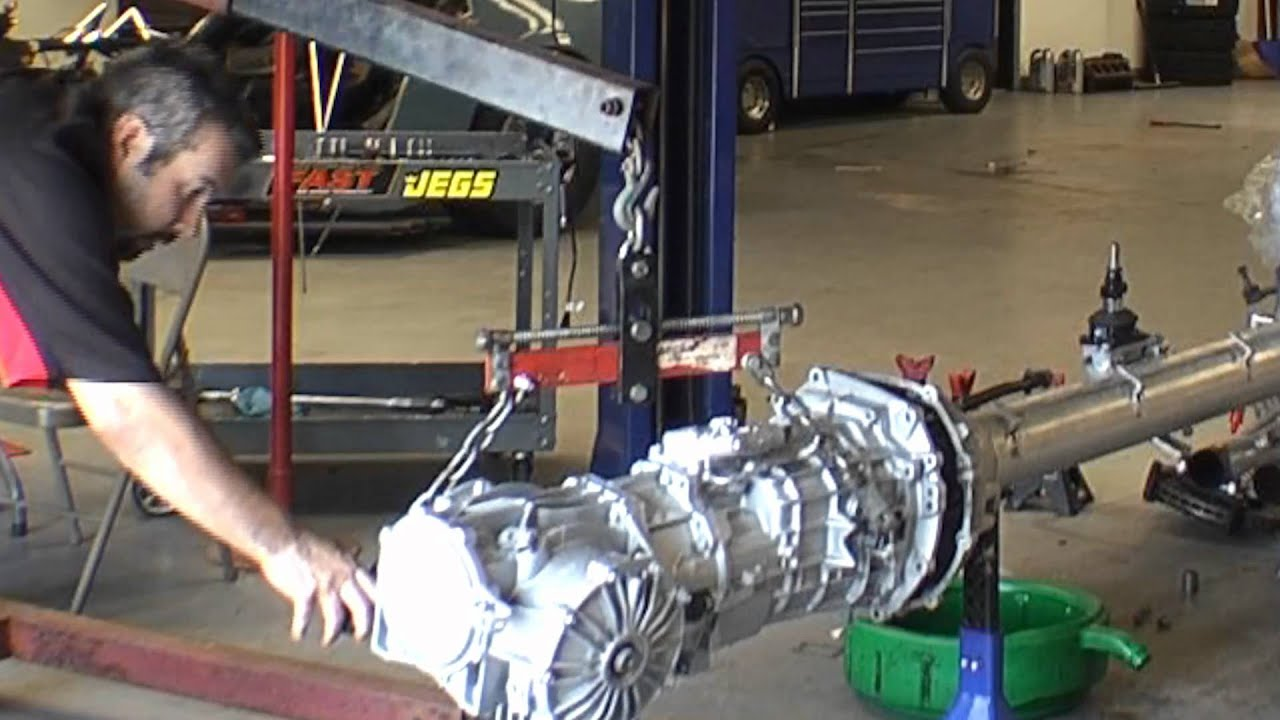 Supposed rebuilt transmission and differential being installed in my car  YouTube