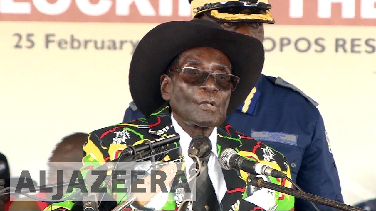At 93rd birthday bash, Robert Mugabe says he won't quit