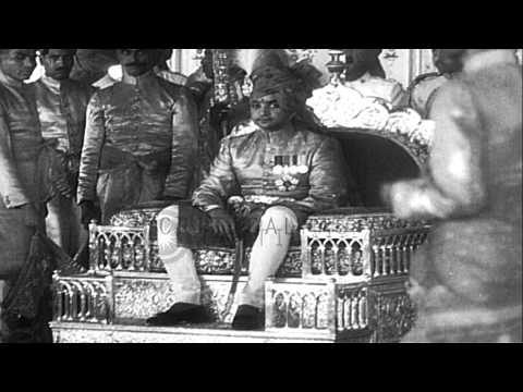 Jaipur Maharajah Sawai Man Singh II sits on his throne and bestows blessings on p...HD Stock Footage