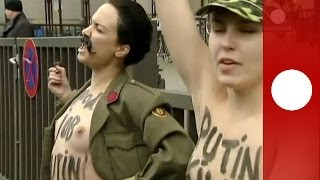 Topless against Putin: Femen activists protest in Brussels