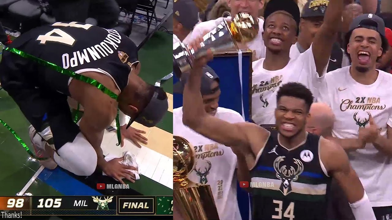 Milwaukee Bucks celebrate with the NBA Finals trophy after game 6 vs Suns