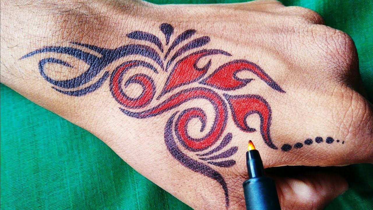 Beautiful Tattoo design for hand with red and black marker