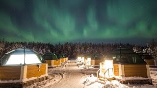 Discovering northern lights in Arctic Glass Igloos in Rovaniemi in Lapland Finland