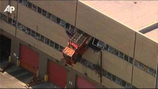 Raw Video: NY Dump Truck Crashes Through Wall