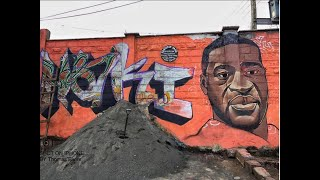 Kibra artists paint a colorful graffiti portrait in honor of George Floyd