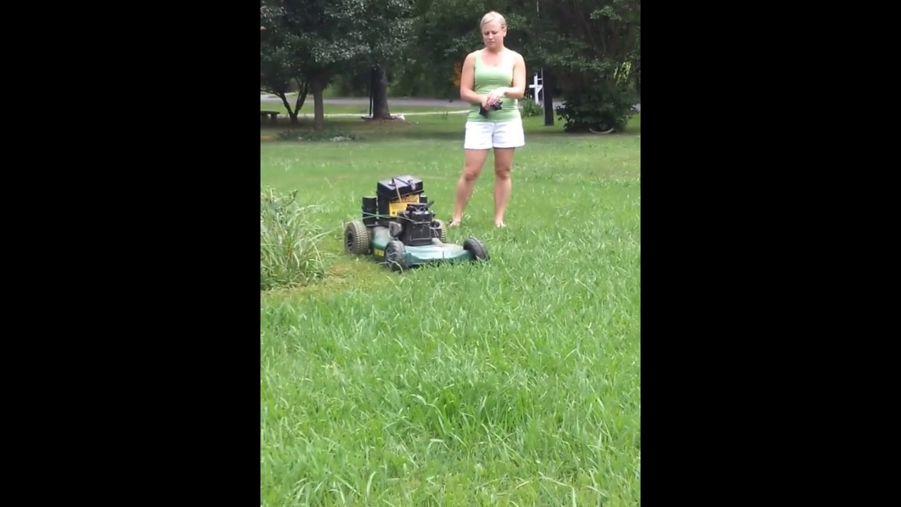 Little girl mowing the lawn! - YouTube