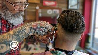 master barber overhauls a haircut shapes a beard