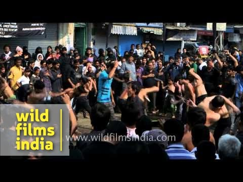 Muslims beat their chests grieving the death of their prophet