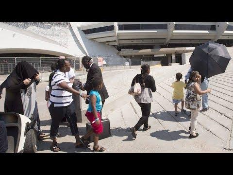 Asylum seekers arrive at Montreal's Olympic Stadium
