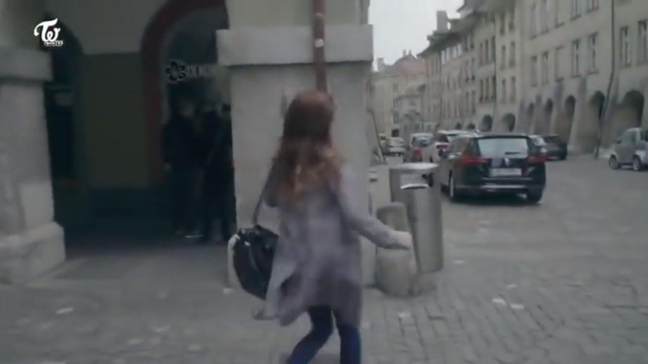 Sana cheerfully greets a trash bin