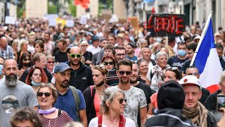 Tens of thousands fill France's streets on third weekend of protests against Covid-19 'health...