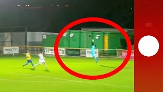 Crazy wind-assisted own goal! Football blown past keeper into net