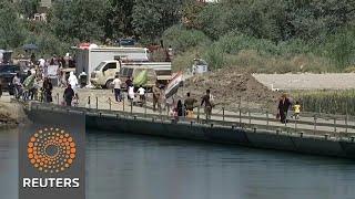 One pontoon bridge connects Mosul