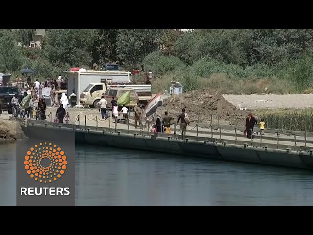 One pontoon bridge connects Mosul's shattered halves