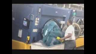 Unloading An Open Pocket Tilting Soft Mount Washer-Extractor