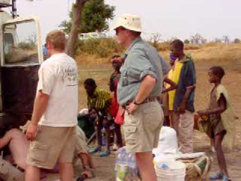 Repairing a Land Rover 88 in Mali With Many Onlookers