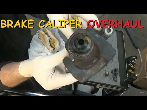 Disc Brake Caliper - Overhaul - YouTube