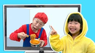 Grandfather pretend play with Yuni's Pororo black noodle and pinkpong jelly through magic smart TV.