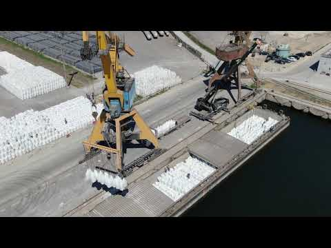 Loading bagged fertilizers shore - barge