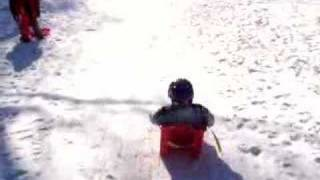 Sam rides the small sledge