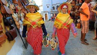 لالة حادة بمدينة شفشاون للإطلاع على طريقة لباسهم و لون صباغتهم
