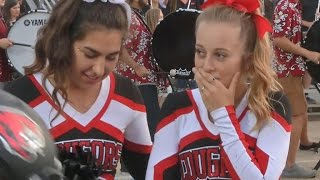 Football players' kind gesture to cheerleader goes viral