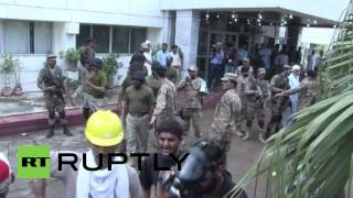 Pakistan: Watch protesters occupy state TV offices in Islamabad