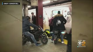 NYPD Searching For Suspects After Video Shows People Riding Motorized Bikes Onto F Train