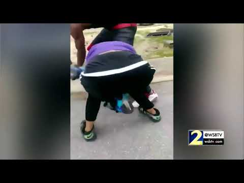 RAW: Video shows teen put gun to girl's head as he tries to break up fight