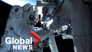 Spacewalking astronauts install solar panels outside ISS