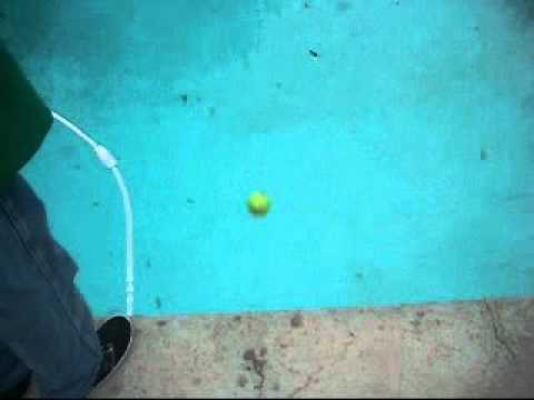 Tennis Ball Coming Up From Water