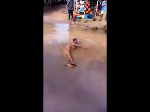 Nigerian Soldiers Beating A Civilian