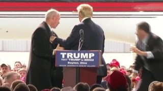 Trump swarmed by security on stage