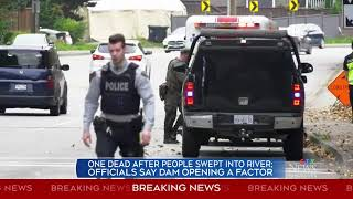 1 dead after people swept into river