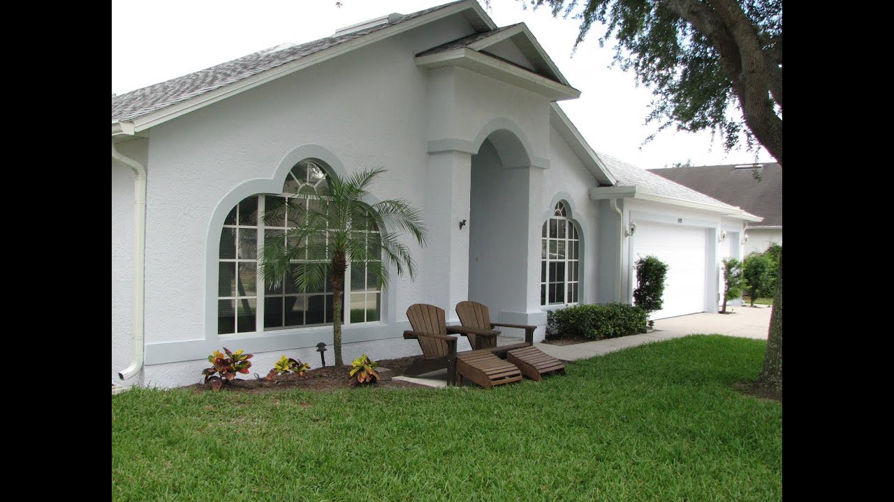 Painting A Merritt Island Homes Exterior Stucco Walls And Doors Before And