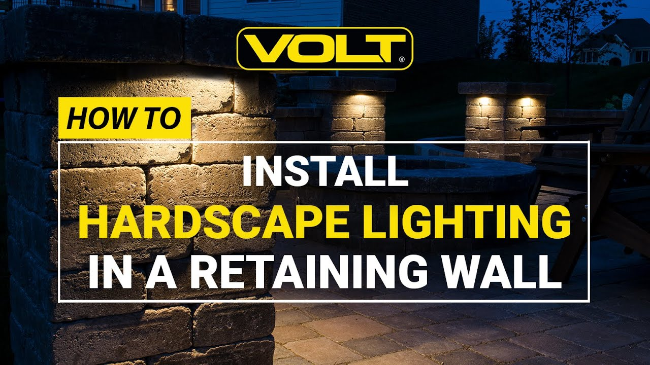 how to install a hardscape light in a retaining wall landscape lighting installation tips