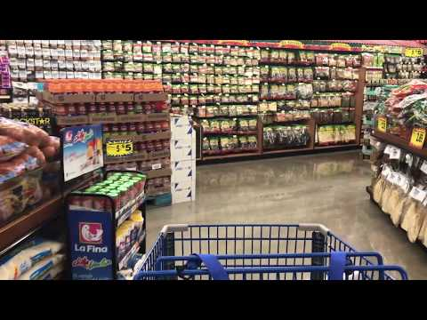 Shopping Cart Moving Through Produce Aisle  - Free Stock Footage